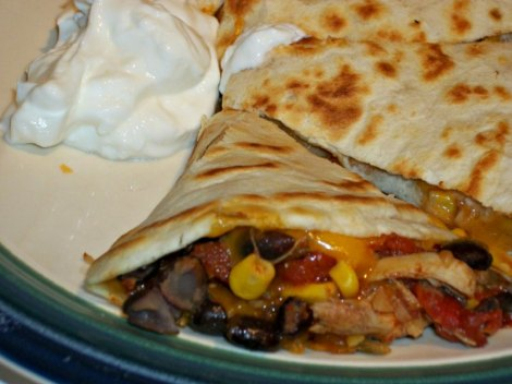 Close up of chicken and black bean quesadilla with greek yogurt