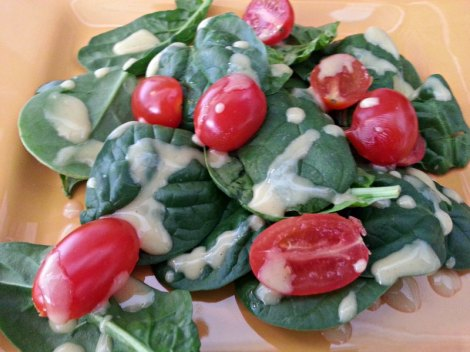 Dressed Spinach and tomatoes