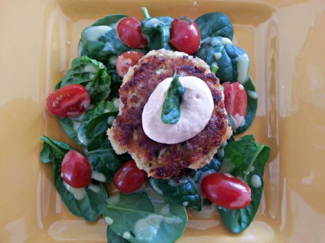 Top view of Prepared salmon patty and salad
