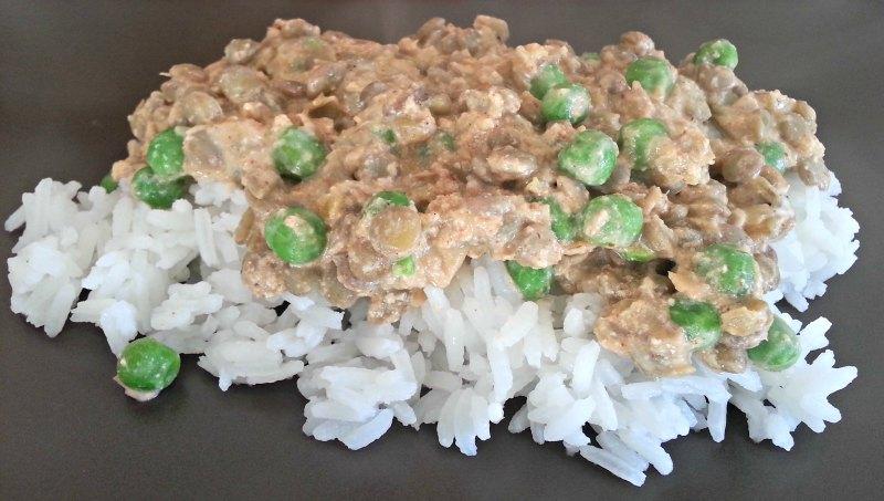 Closeup of Green Lentils and Spiced Yogurt