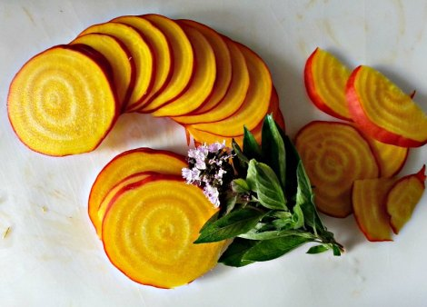 Cut up golden beets and Thai basil