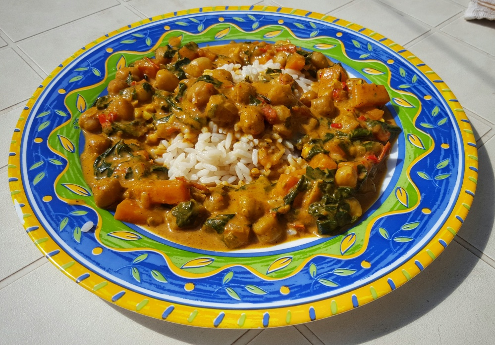 Chickpea and Spinach Curry Served Over Rice